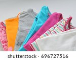 stack colored clothes on a... | Shutterstock . vector #696727516