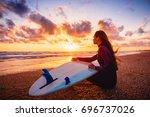 Surfer Girl On Sand Beach With...