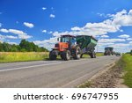 view on red tractor with... | Shutterstock . vector #696747955