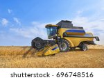 giant yellow working wheat... | Shutterstock . vector #696748516