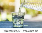 Small photo of Pour drinking water into the glass. Ice in glass and drinking water. Clean drinking water. Drink healthy water.