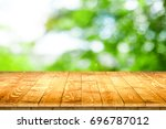 empty wooden table perspective... | Shutterstock . vector #696787012