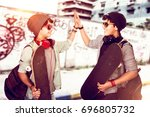 happy teen boys outdoors  two... | Shutterstock . vector #696805732