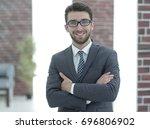 portrait of an experienced... | Shutterstock . vector #696806902
