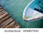 a boat is seen in isla mujeres  ... | Shutterstock . vector #696807442