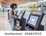 happy woman using the check in... | Shutterstock . vector #696814915