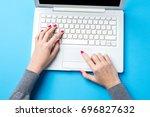 overhead shot of woman using... | Shutterstock . vector #696827632