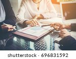 business team working on... | Shutterstock . vector #696831592