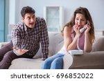 young family in broken... | Shutterstock . vector #696852022