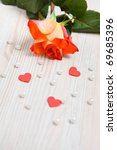 Beautiful rose with pearls and hearts as a gift for Valentine's day - stock photo