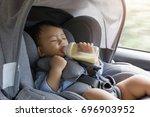 asian cute baby sleepy drinking ... | Shutterstock . vector #696903952
