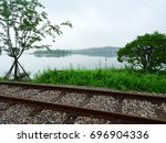 A Lakeside Railway With Trees...