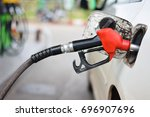 filling car with gasoline at... | Shutterstock . vector #696907696