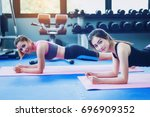 beautiful girls exercise with... | Shutterstock . vector #696909352