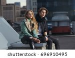 fashion young couple in rock... | Shutterstock . vector #696910495