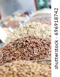 pecan nuts pile at the market... | Shutterstock . vector #696918742
