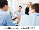 business colleagues discussing... | Shutterstock . vector #696938116