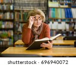 an elderly woman with glasses... | Shutterstock . vector #696940072
