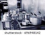 typical kitchen of a restaurant ... | Shutterstock . vector #696948142