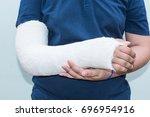 boy with broken arm  plaster on ...   Shutterstock . vector #696954916
