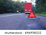 red warning triangle on a road...   Shutterstock . vector #696958222