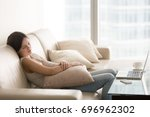 young pretty woman sleeping on... | Shutterstock . vector #696962302