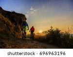 mountain biking women and man... | Shutterstock . vector #696963196