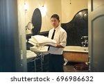 preparing the room for new... | Shutterstock . vector #696986632