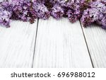 lilac flowers on a old wooden... | Shutterstock . vector #696988012