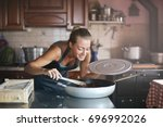 young cook preparing the meal | Shutterstock . vector #696992026