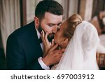 the beautiful bride and groom... | Shutterstock . vector #697003912