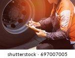driver worker handling... | Shutterstock . vector #697007005