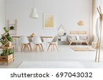 simple dining room and... | Shutterstock . vector #697043032