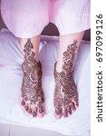 bride showing henna design | Shutterstock . vector #697099126