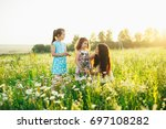 beautiful family in nature. mom ... | Shutterstock . vector #697108282