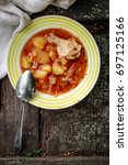 Small photo of Borsch (red tomato soup) with chicken meat