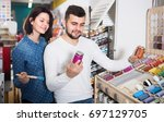 man and woman are deciding on... | Shutterstock . vector #697129705