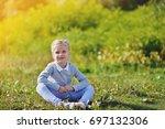 little girl lies on grass in...   Shutterstock . vector #697132306