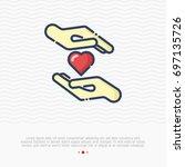heart between two hands thin... | Shutterstock .eps vector #697135726