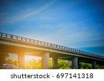 long bridge on the road bridge...   Shutterstock . vector #697141318