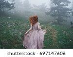 woman in pink dress runs in the ...   Shutterstock . vector #697147606