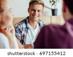 cropped shot of smiling young...   Shutterstock . vector #697155412