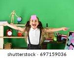 schoolgirl with cheerful face... | Shutterstock . vector #697159036