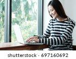 young asian woman using laptop... | Shutterstock . vector #697160692