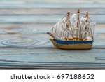 antique toy sailer. on a blue... | Shutterstock . vector #697188652