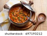 meat and vegetables goulash  or ... | Shutterstock . vector #697193212