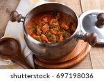 meat and vegetables goulash  or ... | Shutterstock . vector #697198036