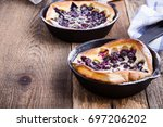blueberry dutch pancakes served ... | Shutterstock . vector #697206202
