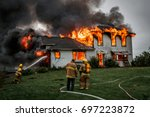 fire fighters putting out a... | Shutterstock . vector #697223872