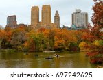 Glorious fall in New York Central park with a tall buildings in the background.
